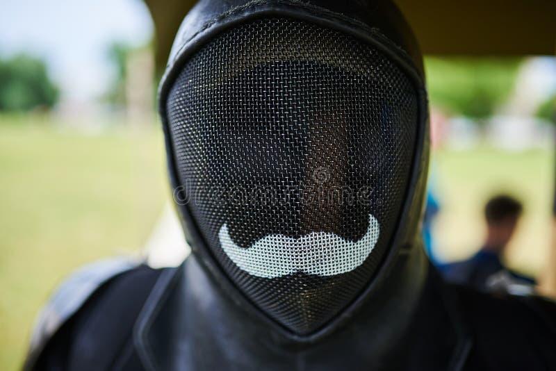 Maskenfechten, schwarz mit einem Schnurrbart stockbilder