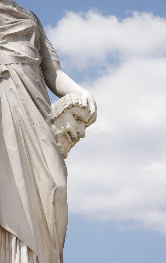 Maskera komedi, detaljen av statyn av den Toussaint J redningen royaltyfria bilder