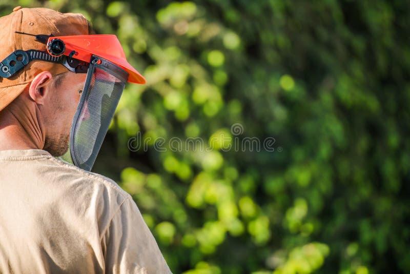 Maskering för framsidasäkerhetsträdgård royaltyfri foto