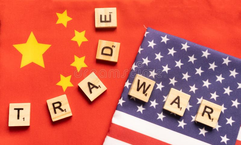 Maski, India 29,May 2019 : China-US trade war concept - flag of China and the United States with wooden block letters stock photo