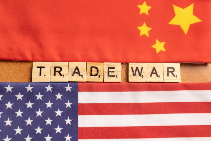 Maski, India 29,May 2019 : China-US trade war concept - flag of China and the United States with wooden block letters.  stock photos