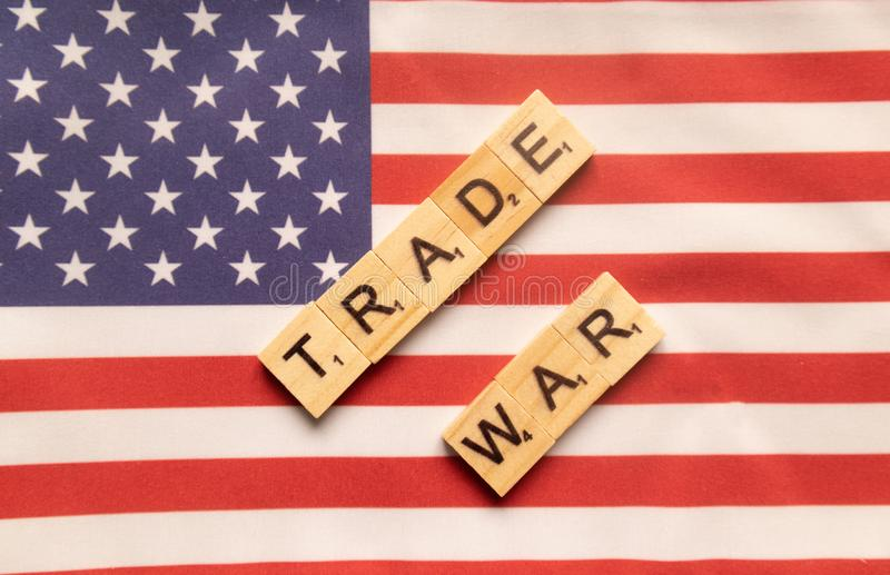 Maski, India 29,May 2019 : China-US trade war concept - flag of the United States with wooden block letters royalty free stock photo