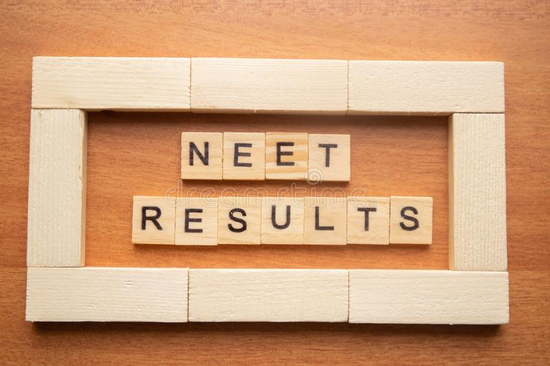 Maski, India 26,May 2019 : NEET or National Eligibility and Entrance Test RESULTS in wooden block letters royalty free stock photo