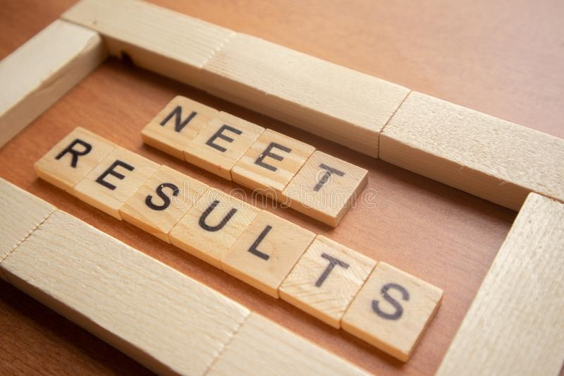 Maski, India 26,May 2019 : NEET or National Eligibility and Entrance Test RESULTS in wooden block letters.  stock images