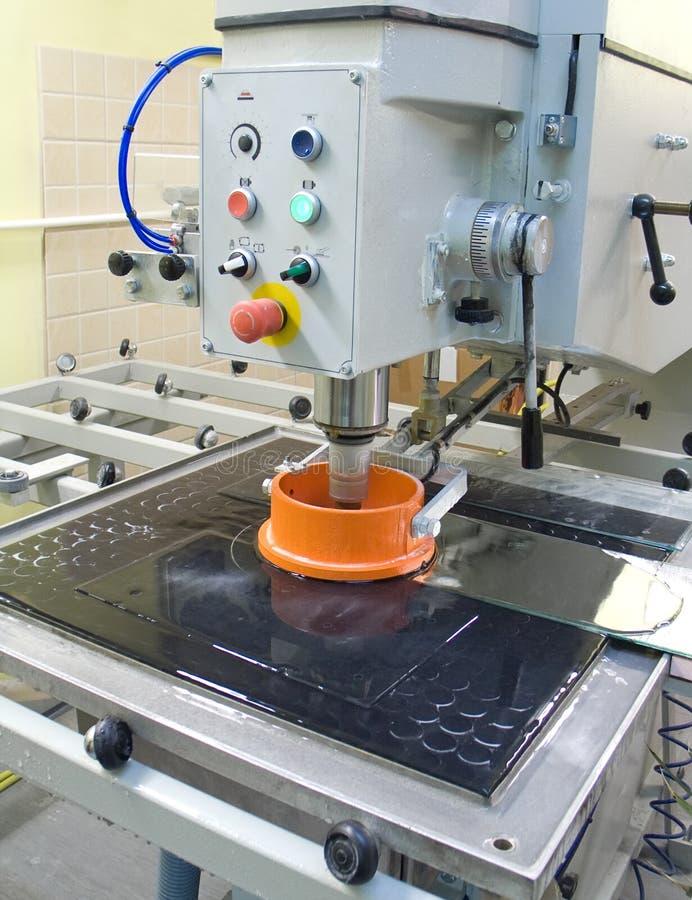 maskin för cuttingexponeringsglas arkivbild