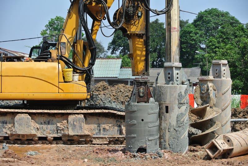 Maskin för tråkmånshögrigg i konstruktionsplatsen arkivbild