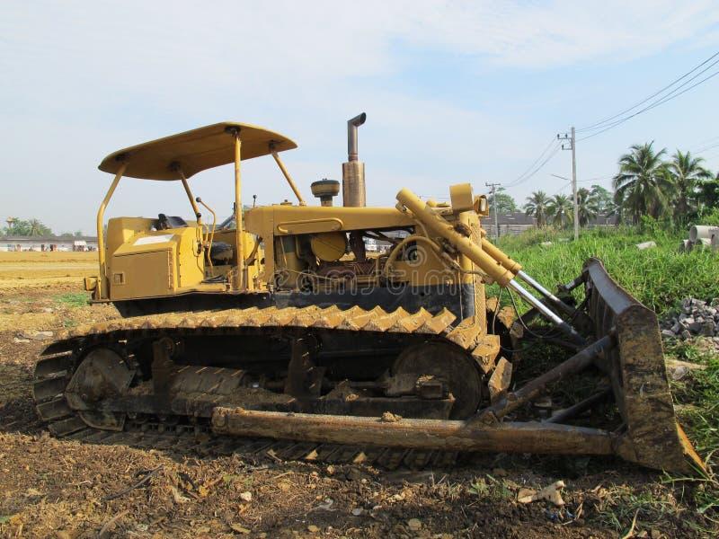 Maskin på land för byggande affärskonstruktionsplats royaltyfri bild