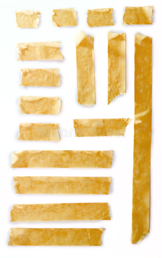 Masking tape. A closeup view of old masking tapes cut in different sizes, isolated on a white background stock photo