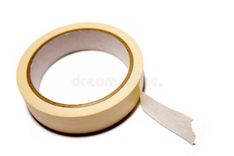 Masking tape. Roll of masking tape on white royalty free stock photo