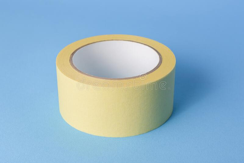 Masking tape on a blue background royalty free stock images