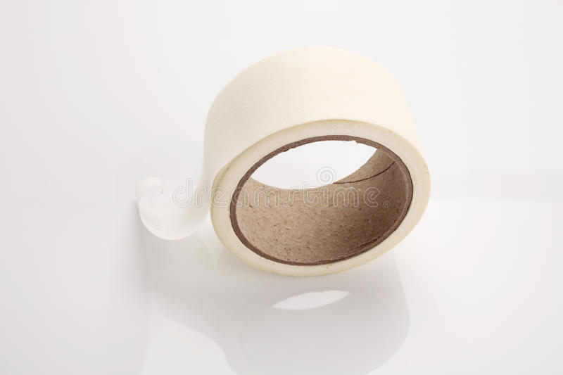 Masking tape. Roll of masking tape on white royalty free stock images