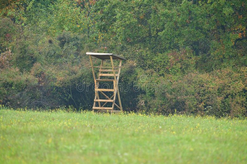 Masking of wooden cottage for hunters in forestwooden lookout tower for birdwatching stock images