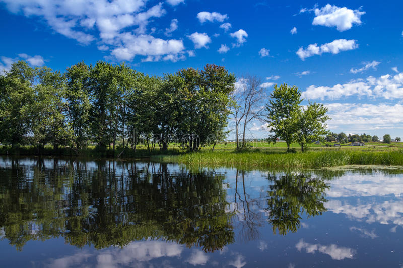 Maskinongé River, Quebec, Canada landscape. In summer with a beautiful blue sky royalty free stock image