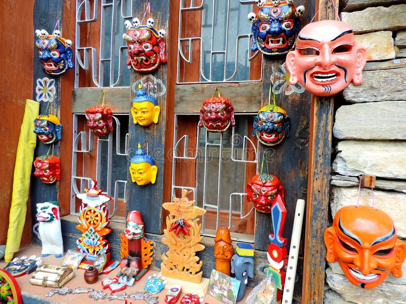 Masks outside National Library of Bhutan, Thimphu. The National Library of Bhutan, Thimphu, Bhutan was established in 1967 for the purpose of preservation and stock photos