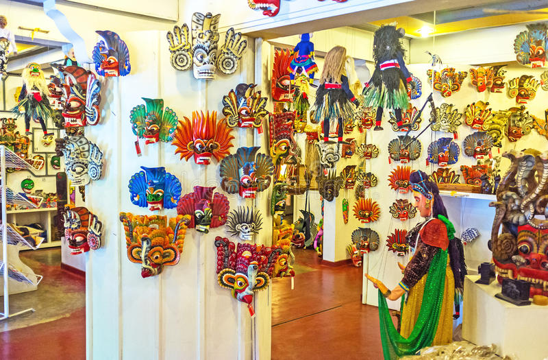 The masks of Sri Lanka. AMBALANGODA, SRI LANKA - DECEMBER 5, 2016: The store next to the Mask Museum offers wide range of traditional wooden masks, the popular royalty free stock image