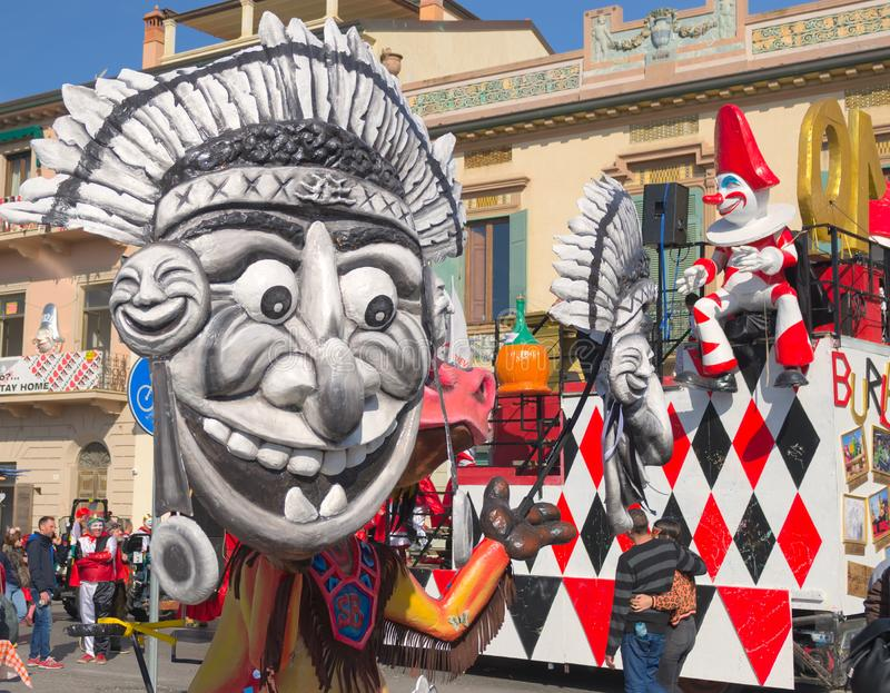 Among the masks there is -the burlamacco- typical mask of Viareggio. 2019 Carnival of Viareggio, Tuscany, Italy-1 stock photo