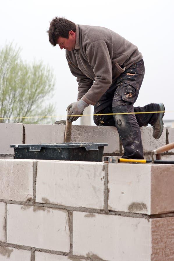 Mason. At work, building a new wall stock photo