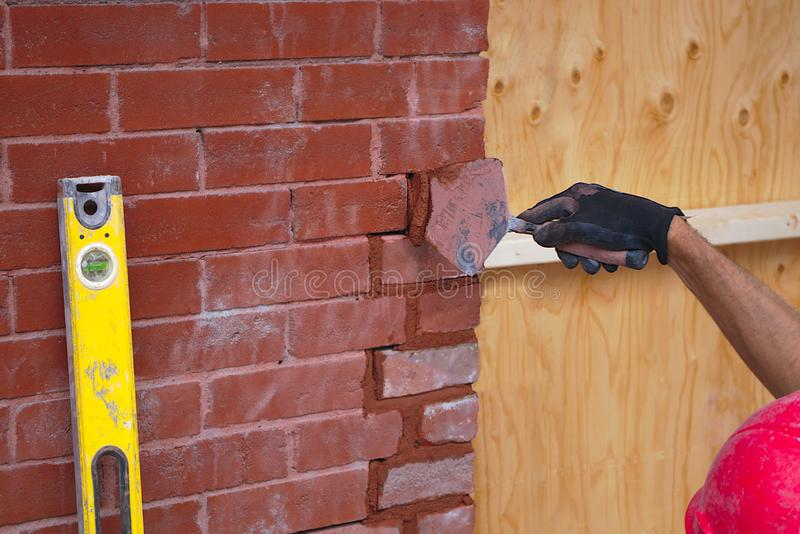 Construction mason brick wall builder worker bricklayer masonry concrete tool royalty free stock images