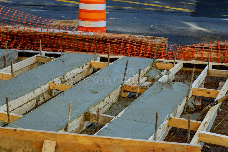 Mason building a screed coat cement at floor work. pouring concrete pavement. Mason building a screed coat cement at floor work. selective . pouring concrete stock photo