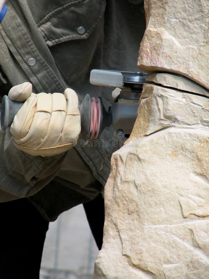 Mason cutting sandstone royalty free stock photography