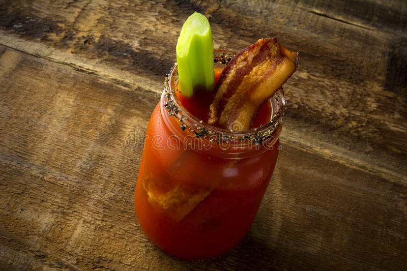 Mason Jar Bacon Bloody Mary arkivbild