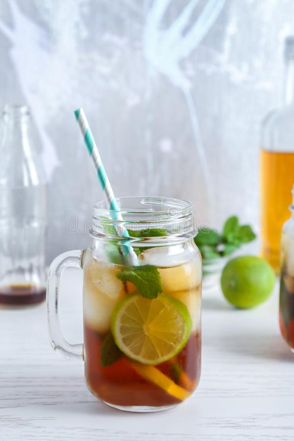 Mason jar with Cuba Libre cocktail. On table royalty free stock images