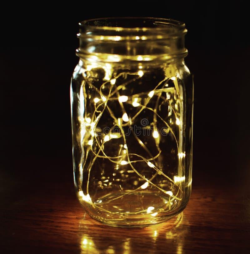 Mason jar lights. Mason jar with glimmer lights royalty free stock photos