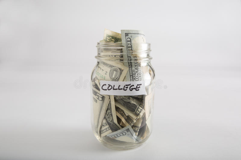 Mason jar with money for college. Closeup of Mason jar with money for college stock photography