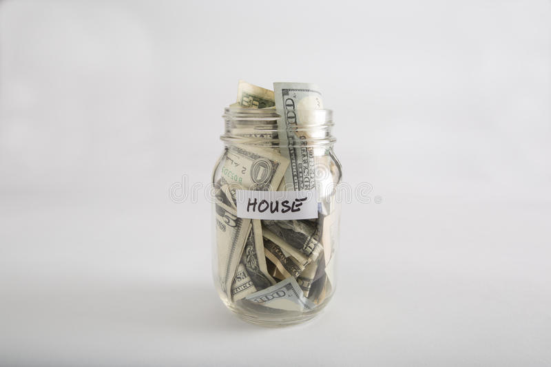 Mason jar with money for House royalty free stock image