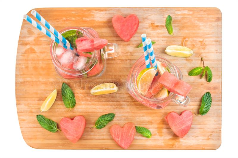 Mason jars drink with lime and mint on wooden tray isolated on white stock images