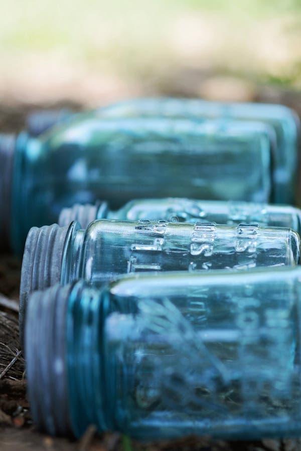 Mason jars. Row of vintage glass mason jars outdoors stock image