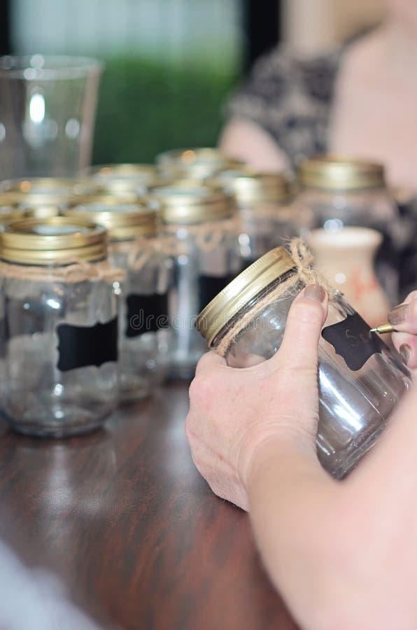 Mason jars. Writing on mason jars for beverages at a party royalty free stock photo
