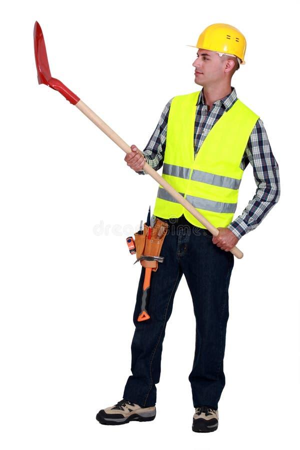 Mason lifting shovel stock images