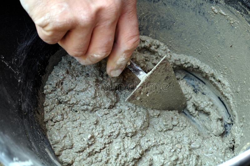 Download Mason preparing cement stock image. Image of mixing, worker - 13541141