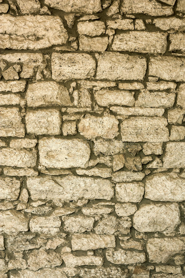 The Masonry Of An Ancient Stone Wall Eroded. Close-up Stock Image ...