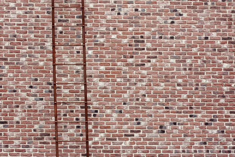 Masonry great coverage. The texture of the red brick wall with a ladder. Brickwork royalty free stock photos