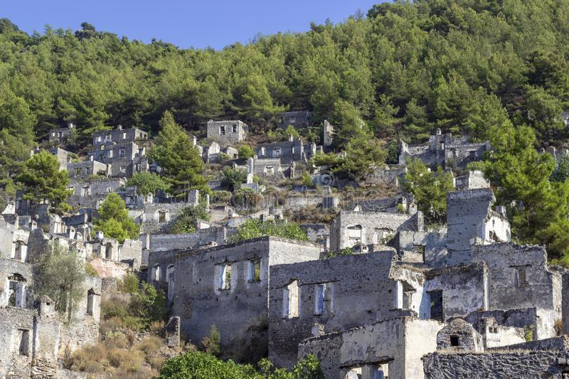 Masonry rocky houses of an old village in Turkey founded by old Greeks with background of forest. Beautiful shoot stock photography