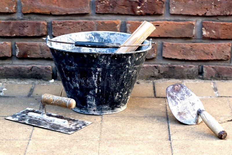Masonry tools. Near a brick wall stock photo