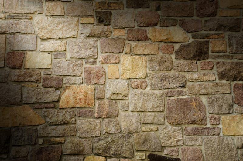 Download Masonry Wall Of Multicolored Stone Lit Diagonally Stock Photo - Image: 28289484