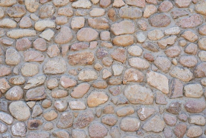Masonry wall of a stones, pattern texture background royalty free stock photo