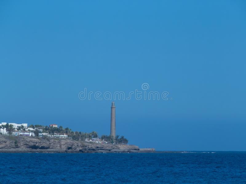 Maspalomas Lighthouse, Gran Canaria. Gran Canaria/Spain - August 8 2019: The Maspalomas Lighthouse is an active 19th century lighthouse at the southern end of royalty free stock photography