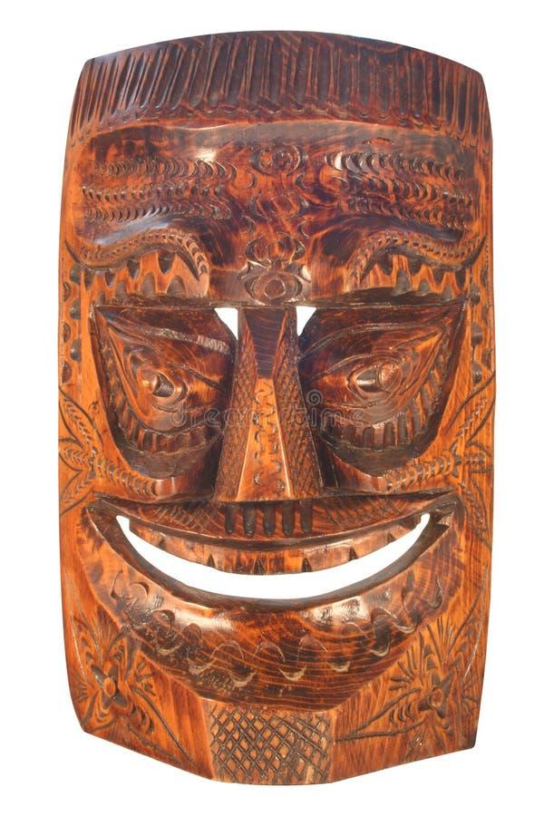 Masque de Tiki découpé par bois images stock