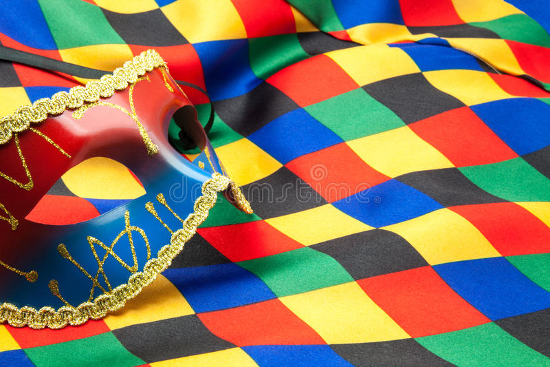 Masque et tissu de harlequin images stock