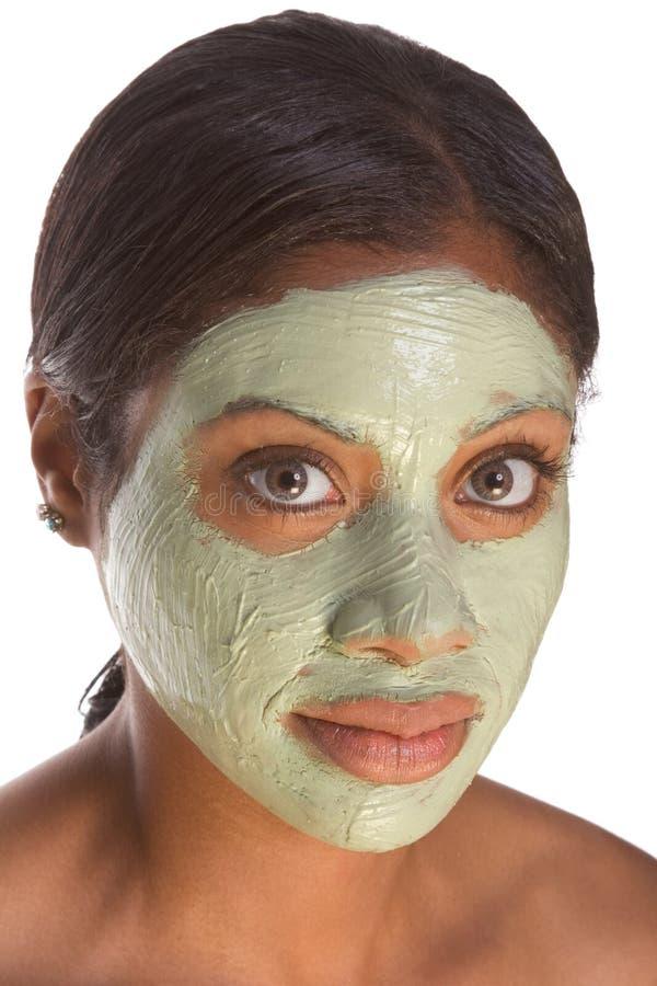 Masque facial sur la fille noire photographie stock