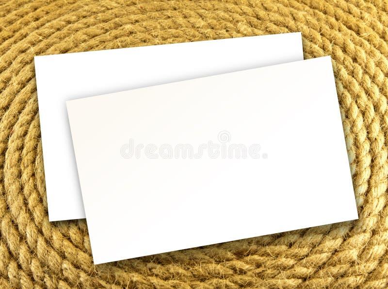 Masque les cartes de visite professionnelle de visite blanches sur un fond de corde, desig d'identité photographie stock libre de droits