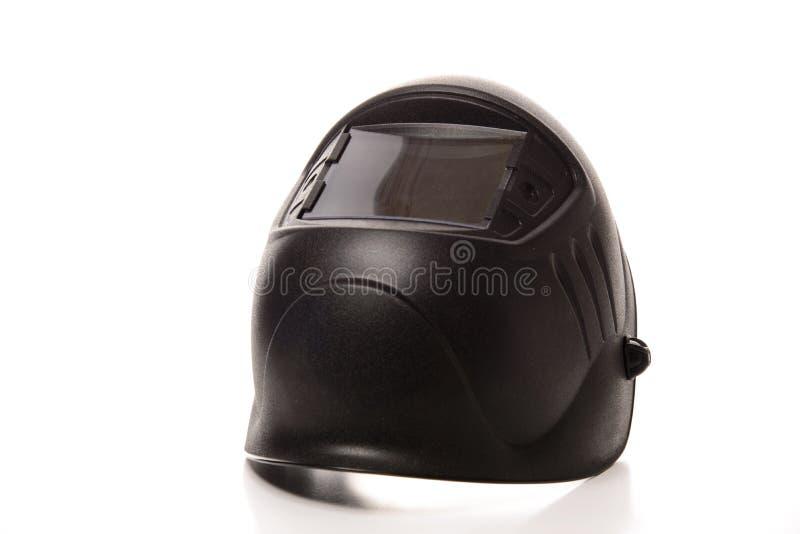 Masque noir de soudure d'isolement sur le fond blanc pur photos stock
