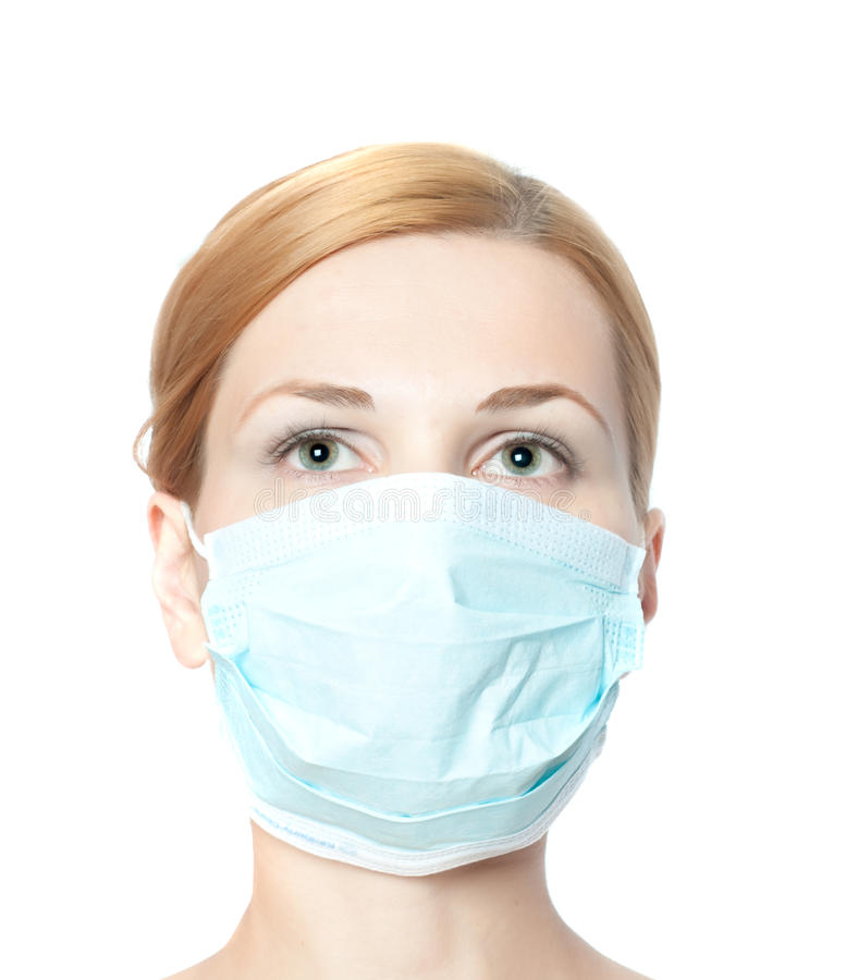 Masque s'usant de docteur féminin photographie stock