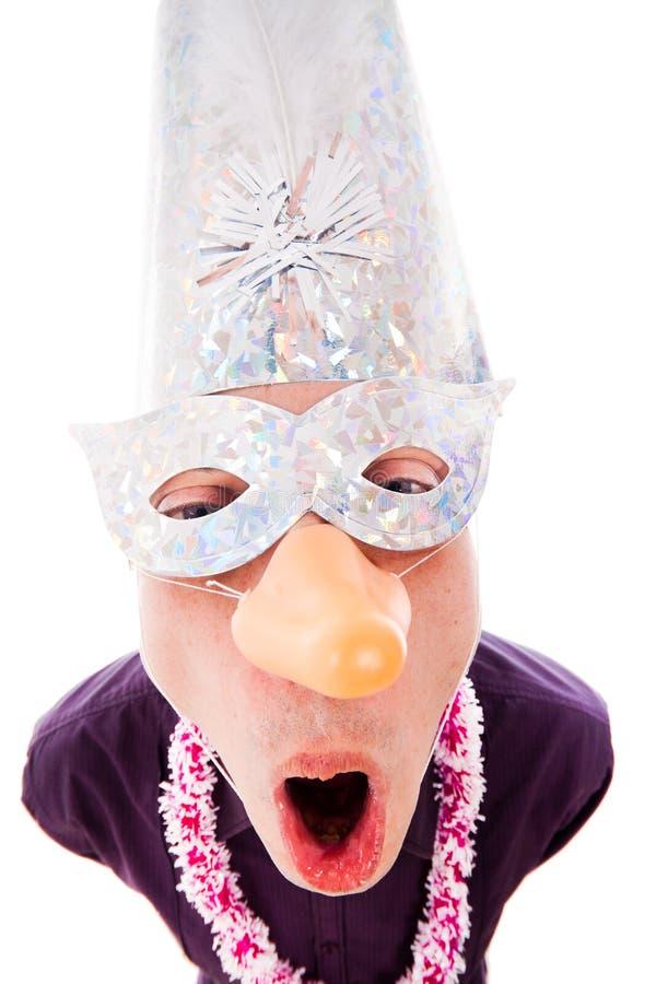 Masque s'usant de réception d'homme drôle photographie stock libre de droits