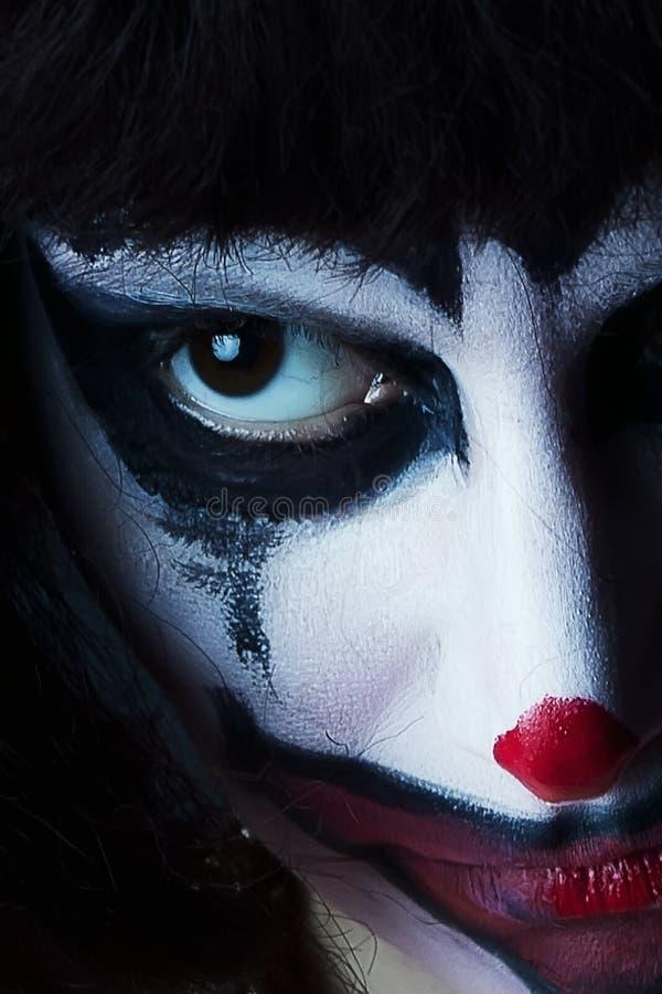 Masque triste de clown sur le visage de femme photo stock
