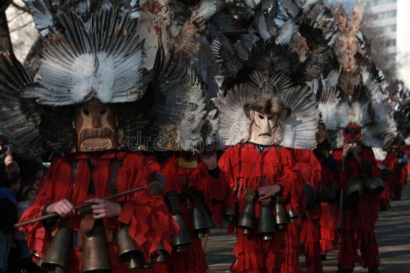 Masquerade festival Surva in Pernik. PERNIK, BULGARIA - JANUARY 30, 2016 - Masquerade festival Surva in Pernik, Bulgaria. People with mask called Kukeri dance royalty free stock photo